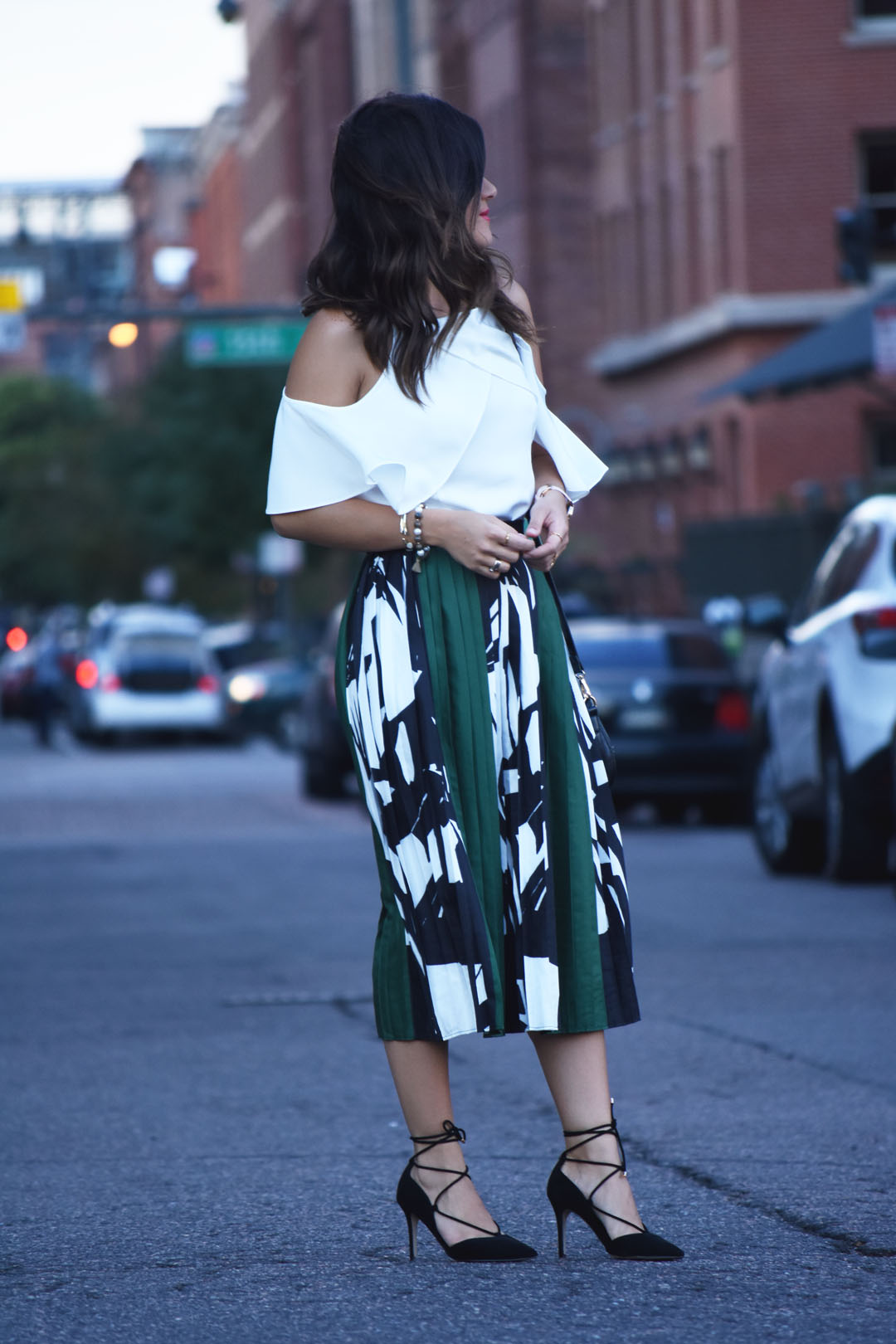 42c262b550f Carolina Hellal of Chic Talk wearing a pleated green skirt and cold shoulder  top - PLEATED